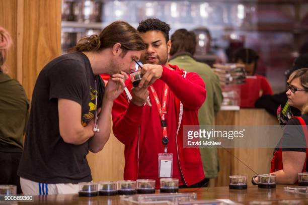 A customer smells a cannabis product at MedMen one of the two Los Angeles area pot shops that began selling marijuana for recreational use under the...