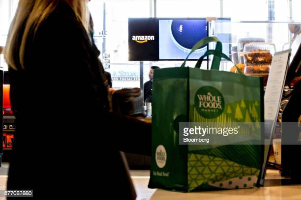 A customer stands at a coffee bar in front of an Amazoncom Inc PopUp store inside the Lakeview Whole Foods Market Inc store in Chicago Illinois US on...