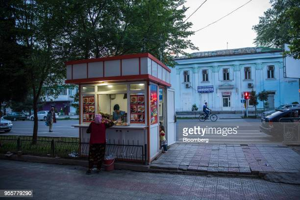 A customer stands at a food kiosk in Dushanbe Tajikistan on Sunday April 22 2018 Flung into independence after the Soviet Union collapsed in 1991 the...