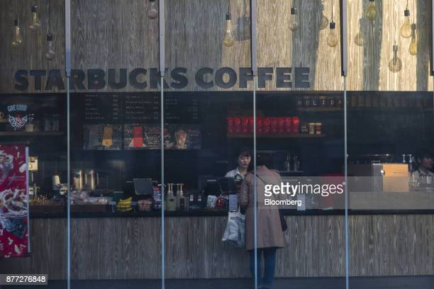 A customer stands at the counter of a Starbucks Corp store in the Shibuya district of Tokyo Japan on Thursday Nov 16 2017 Japans economy grew for a...