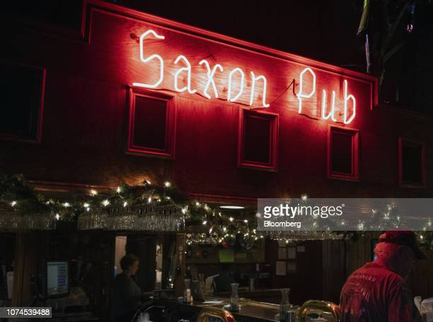 A customer stands near the bar at the Saxon Pub in Austin Texas US on Thursday Dec 20 2018 Apple Inc announced this month it's opening new offices in...