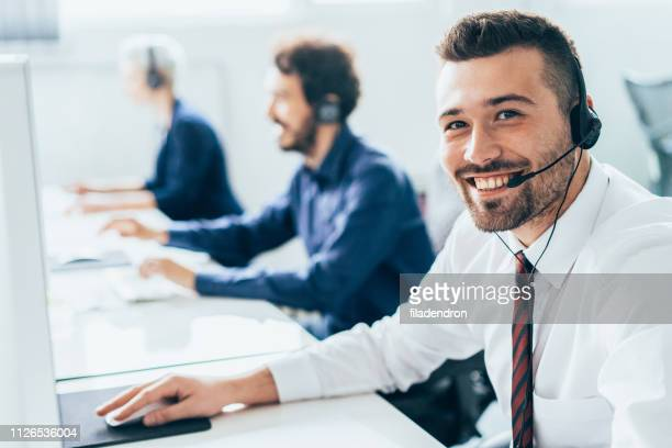 customer support operator with headset - contact us stock pictures, royalty-free photos & images