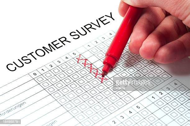 customer survey with hand and pen