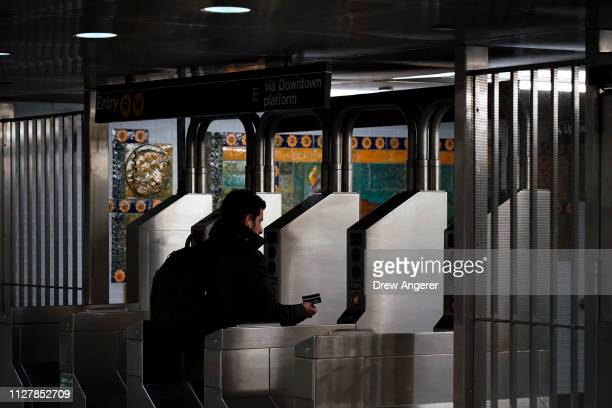 Customer swipes her metro card as she moves through the turnstiles at the Fulton Center subway station, February 27, 2019 in New York City. On...