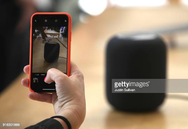 A customer takes a picture of the new Apple HomePod at an Apple Store on February 9 2018 in San Francisco California Apple's new HomePod went on sale...