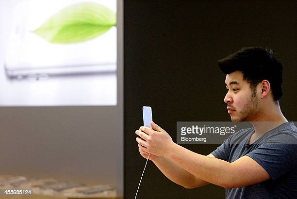 """Customer takes a """"selfie"""" photograph using an iPhone 6 at the Apple Inc. George Street store during the sales launch of the iPhone 6 and iPhone 6..."""