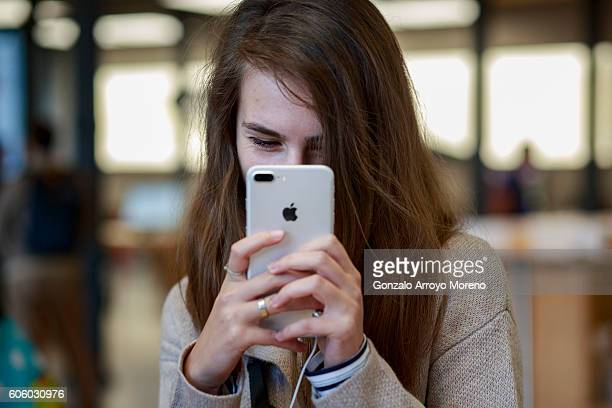 A customer takes a selfie with a new Iphone 7 exhibited at Puerta del Sol Apple Store the day the company launches their Iphone 7 and 7 Plus on...