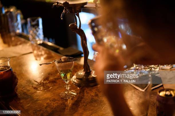 Customer takes a video of absinthe at the bar inside Risky Business, a private members-only club, that was once The Other Door but closed during the...