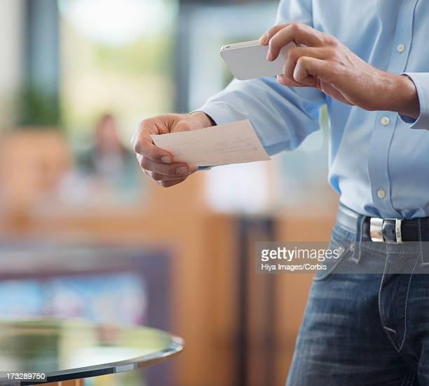 Customer taking photo of bank receipt