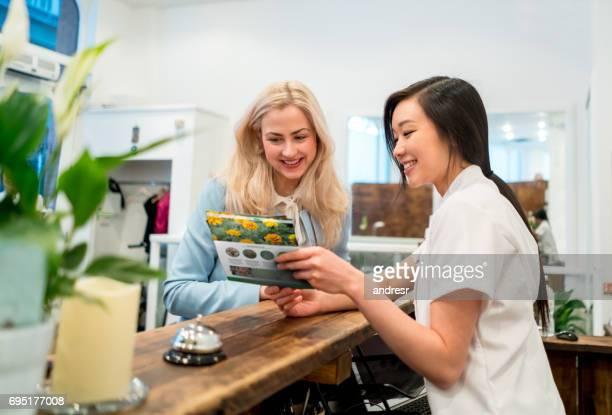 Customer talking to a masseuse at the spa