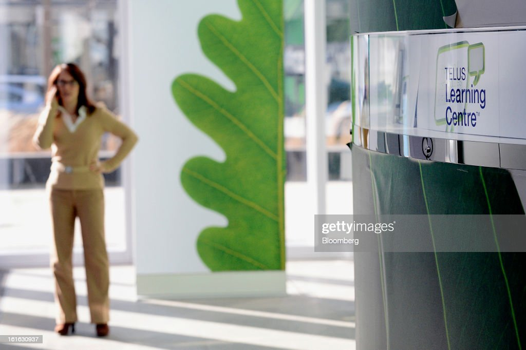 A customer talks on a mobile phone at a Telus Corp. learning center and store in Toronto, Ontario, Canada, on Wednesday, Feb. 13, 2013. Telus Corp. is scheduled to release earnings data on Feb. 15. Photographer: Aaron Harris/Bloomberg via Getty Images