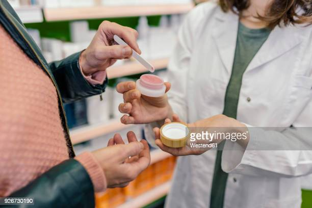Customer testing cosmetics in pharmacy