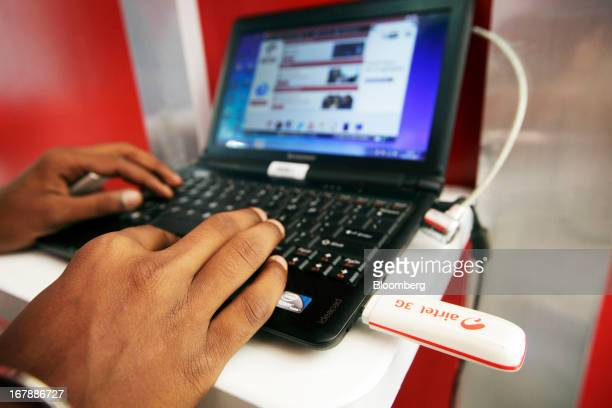 A customer tests the Bharti Airtel Ltd 3G USB Modem 72 Mbps with a Lenovo IdeaPad at the company's flagship store in Mumbai India on Thursday May 2...