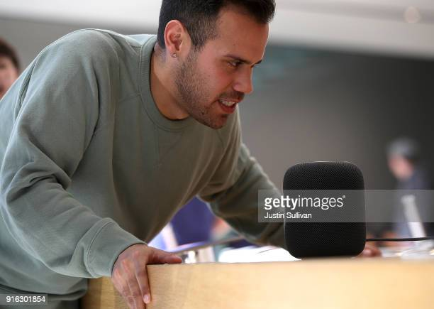 A customer tests the new Apple HomePod at an Apple Store on February 9 2018 in San Francisco California Apple's new HomePod went on sale today at...