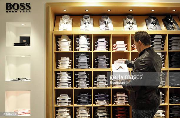 Customer Tom Adlmeier looks at a shirt at a Hugo Boss AG shop in Rosenheim Germany on Friday Oct 30 2009 Hugo Boss AG's thirdquarter net income fell...