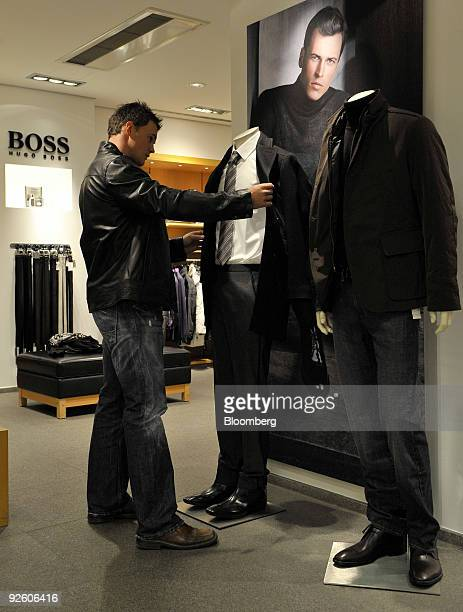 Customer Tom Adlmeier looks at an outfit on display at a Hugo Boss AG shop in Rosenheim Germany on Friday Oct 30 2009 Hugo Boss AG's thirdquarter net...