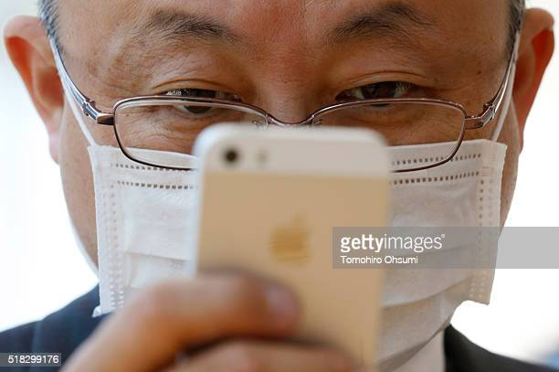 A customer tries an Apple Inc iPhone SE at the company's Omotesando store on March 31 2016 in Tokyo Japan Apple Inc launched its iPhone SE and iPad...