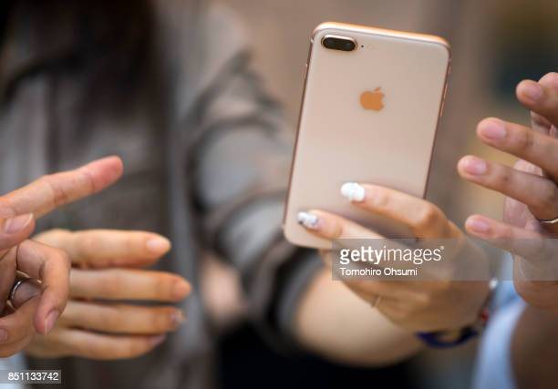 A customer tries an Apple iPhone 8 Plus at the Apple Omotesando store on September 22 2017 in Tokyo Japan Apple's iPhone 8 and iPhone 8 Plus went on...