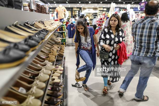 A customer tries on a pair of shoes at a Big Bazaar hypermarket operated by Future Retail Ltd in Mumbai India on Sunday April 16 2017 Future Retail...