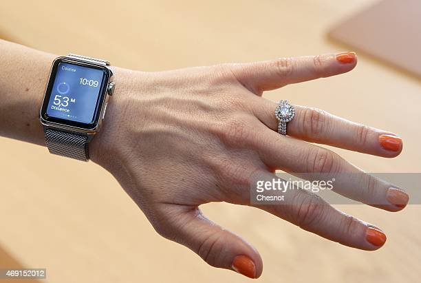 A customer tries on an Apple Watch smartwatch at Galeries Lafayette Paris Haussmann on April 10 2015 in Paris France Preorders for the Apple Watch...