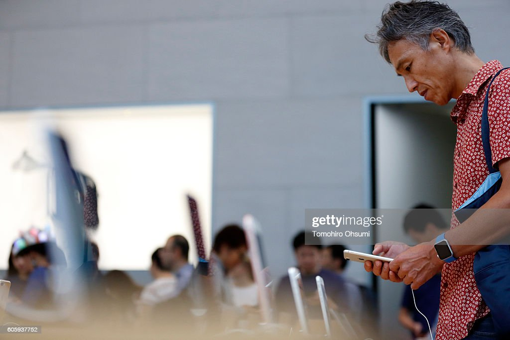 A customer tries out an Apple Inc. iPhone 7 Plus at the company's Omotesando store on September 16, 2016 in Tokyo, Japan. Apple's iPhone 7 and Apple Watch Series 2 go on sale in Japan today.