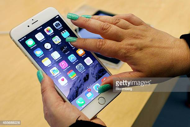 Customer tries out an iPhone 6 Plus at the Apple Inc. George Street store during the sales launch of the iPhone 6 and iPhone 6 Plus in Sydney,...
