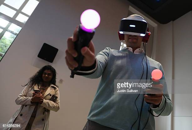 A customer tries the new PlayStation VR at Sony Square NYC on October 13 2016 in New York City Sony launched its $399 PlayStation VR that links to...