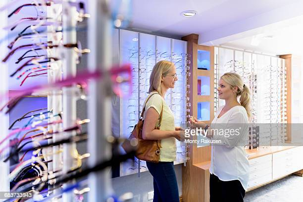 Customer trying on frames at small business opticians