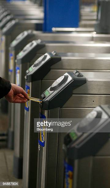 PATH customer uses a fare card in a turnstile at the 33rd Street Station in in New York US on Friday Feb 29 2008 New York City commuters will pay...