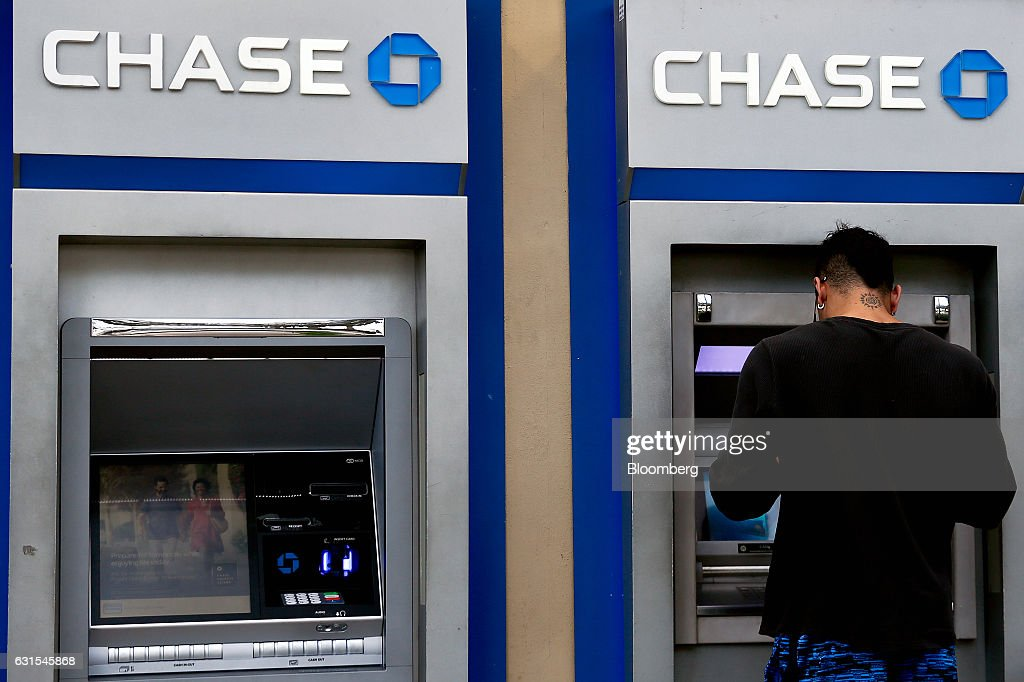 A customer uses a JPMorgan Chase & Co  automatic teller machine