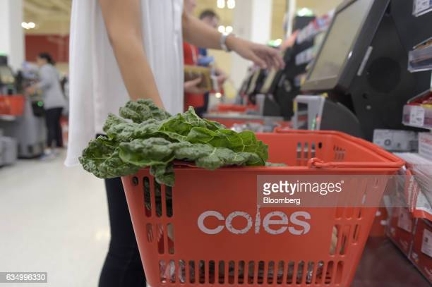 A customer uses a self checkout counter in a Coles supermarket operated by Wesfarmers Ltd in the Richmond area of Melbourne Australia on Friday Feb...