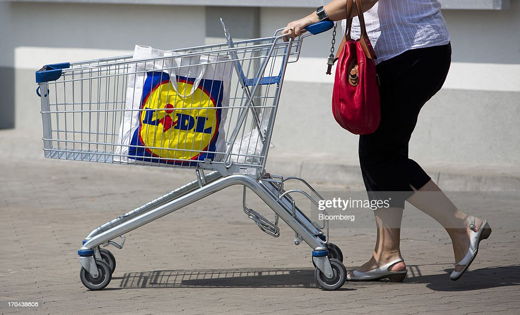 A customer uses a shopping cart to move her purchases across the parking lot outside a Lidl discount supermarket store, operated by Schwarz Group, in Prague, Czech Republic, on Thursday, June 13, 2013. Ahold and Tesco are tied as the Czech Republic's third-largest grocer by revenue behind Lidl discount store owner Schwarz Group and Rewe AV, which owns the Billa supermarkets, according to Krakow, Poland-based market researcher PMR. Photographer: Martin Divisek/Bloomberg via Getty Images