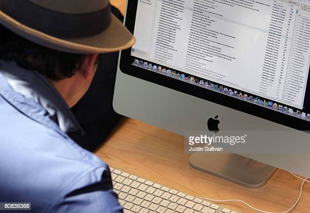 A customer uses an Apple iMac computer at an Apple Store April 23 2008 in San Francisco California Apple reported its second quarter profits today as...