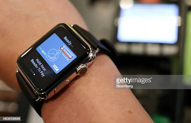 A customer uses an Apple Inc Apple Watch to pay via the Apple Pay system from their Nationwide account at the checkout till inside a Pret A Manger...