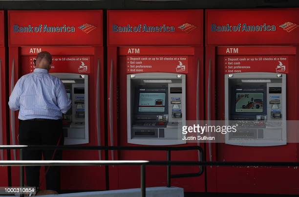 A customer uses an ATM machine at a Bank of America office on July 16 2018 in San Francisco California Bank of America reported stronger than...