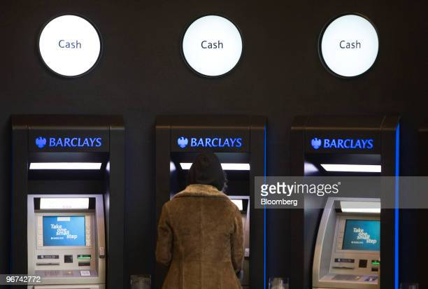 A customer uses an ATM machine at a branch of Barclays bank part of Barclays Plc in London UK on Tuesday Feb 16 2010 Barclays Plc the UK's...