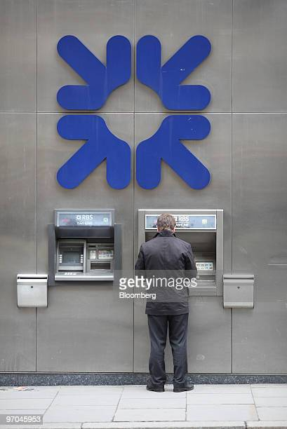 A customer uses an ATM outside the headquarters of the Royal Bank of Scotland in London UK on Thursday Feb 25 2010 Royal Bank of Scotland Group Plc...