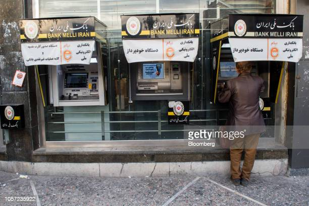 A customer uses an automated teller machine at a Bank Melli Iran Inc branch in Tehran Iran on Saturday Nov 3 2018 Irans Supreme Leader Ayatollah...