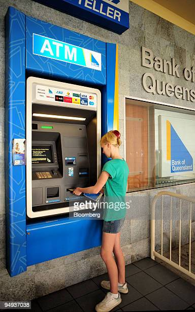 A customer uses an automated teller machine at a branch of the Bank of Queensland in Brisbane Australia on Sunday Jan 11 2009 Bank of Queensland Ltd...