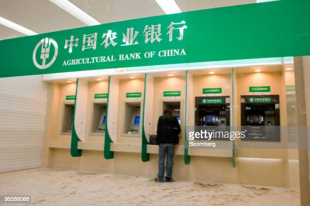 A customer uses an automated teller machine at a branch of the Agricultural Bank of China in Beijing China on Tuesday Jan 5 2010 Agricultural Bank of...