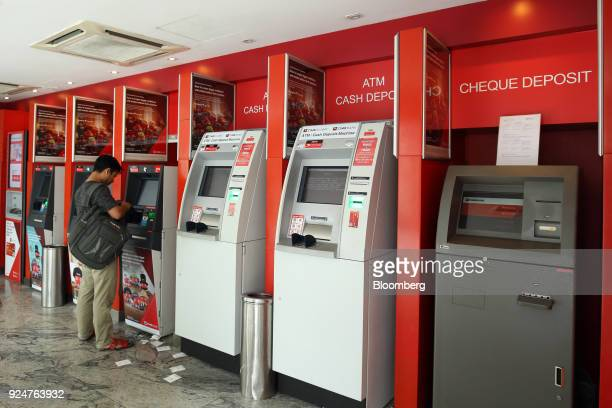 A customer uses an automated teller machine at a CIMB Bank Bhd branch in Kuala Lumpur Malaysia on Sunday Feb 25 2018 CIMB is Malaysia's secondlargest...