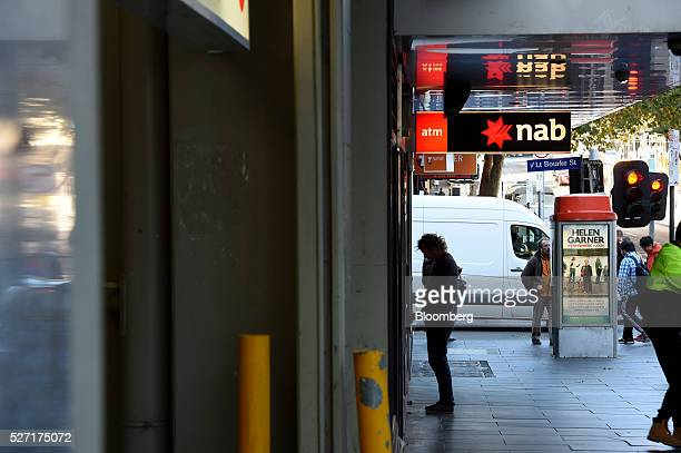 A customer uses an automated teller machine at a National Australia Bank Ltd branch in Melbourne Australia on Monday May 2 2016 National Australia is...