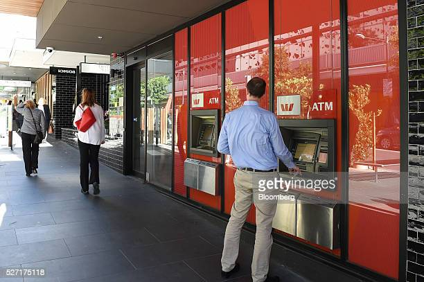 A customer uses an automated teller machine at a Westpac Banking Corp branch in Melbourne Australia on Monday May 2 2016 Westpac which increased...