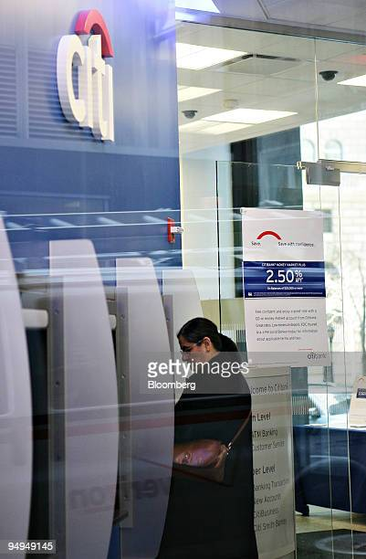 a customer uses an automated teller machine inside a citibank branch in new york us on