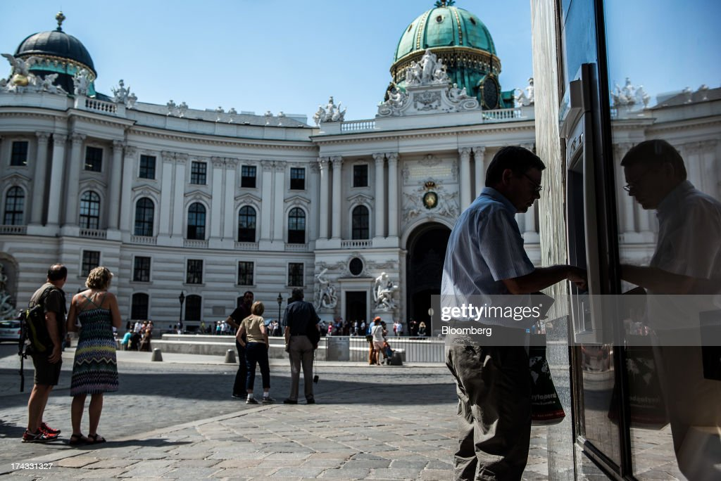 A customer uses an automated teller machine (ATM) near the Hofburg Palace in Vienna, Austria, on Tuesday, July 23, 2013. Kommunalkredit Austria AG, the Austrian nationalized municipal lender, will have to wind down its loan book and close when that's complete after attempts to sell the bank failed, the European Commission said. Photographer: Akos Stiller/Bloomberg via Getty Images