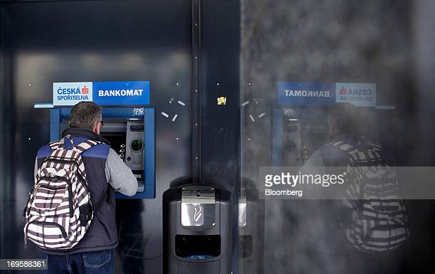 A customer uses an automated teller machine operated by Ceska Sporitelna AS the Czech unit of Erste Group Bank AG in Prague Czech Republic on Monday...