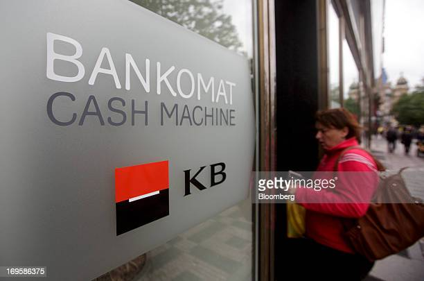 A customer uses an automated teller machine operated by Komercni Banka AS in Prague Czech Republic on Monday May 27 2013 Czech policy makers are in...