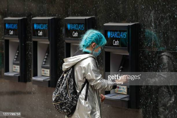 A customer uses an automated teller machine outside a Barclays Plc bank branch in London UK on Monday July 27 2020 The Treasury is in talks with the...