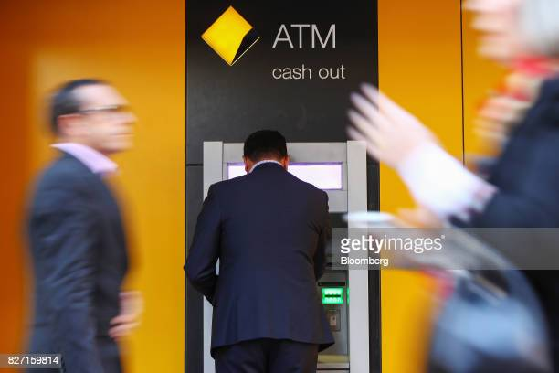 A customer uses an automated teller machine outside a Commonwealth Bank of Australia branch in Sydney Australia on Monday Aug 7 2017 Commonwealth...