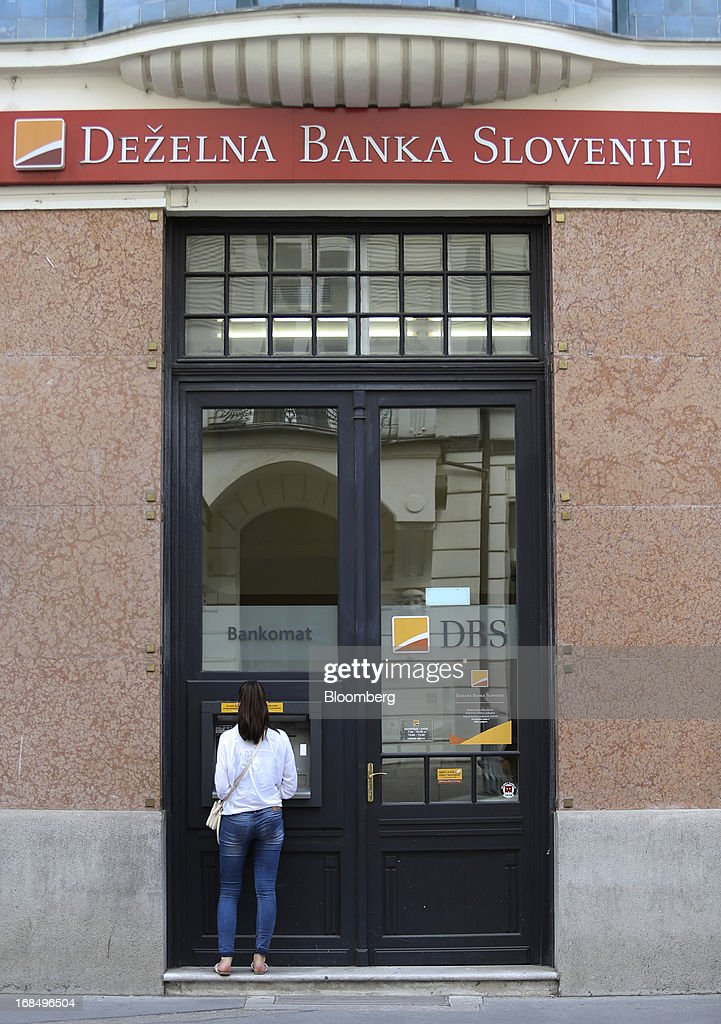 A customer uses an automated teller machine (ATM) outside a Dezelna Banka Slovenije d.d. bank branch in Ljubljana, Slovenia, on Friday, May 10, 2013. The Adriatic nation is seeking to fix its ailing lenders with a cash injection of at least 900 million euros ($1.17 billion) after Cyprus's bailout focused investors on countries with weak banking industries. Photographer: Chris Ratcliffe/Bloomberg via Getty Images